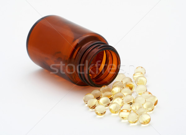 Pills out from the bottle (small DOF) Stock photo © broker