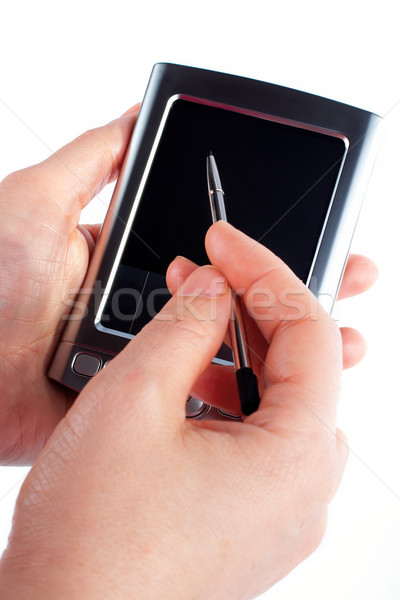 Business woman writing on a pda organizer Stock photo © broker