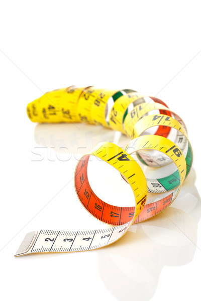 Curled measuring tape Stock photo © broker