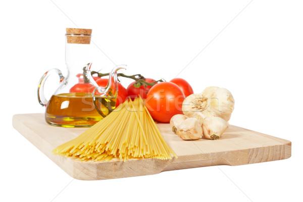 Pomidory oliwy czosnku spaghetti odizolowany biały Zdjęcia stock © broker