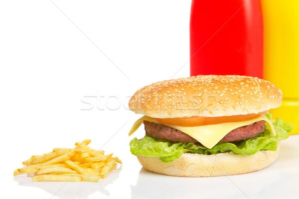 Hamburguesa con queso mostaza salsa de tomate botellas blanco Foto stock © broker