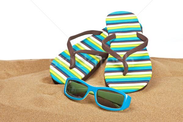 Flipflops on the sand Stock photo © broker
