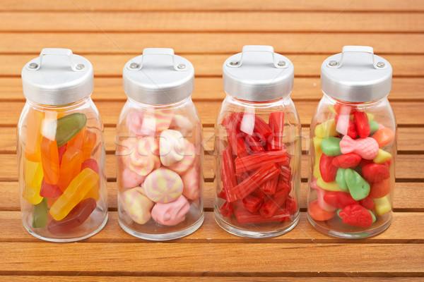 Glass jars of candies Stock photo © broker