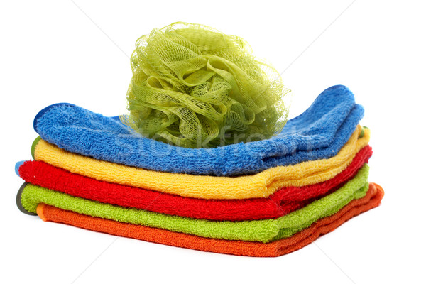 Multicolour towels stacked and body sponge Stock photo © broker