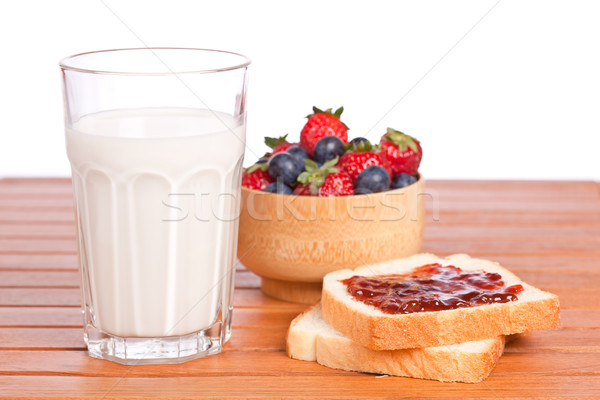 Two toast with jam, blueberries and strawberries Stock photo © broker