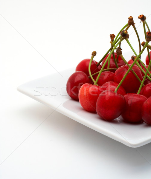 Stock photo: Cherries on the white plate