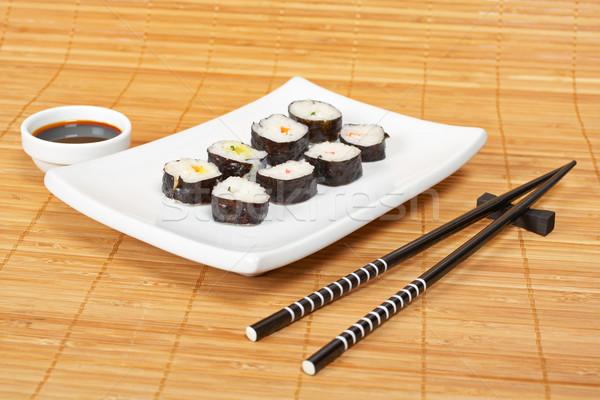 Sushi soya sosu beyaz plaka Çin yemek çubukları bambu Stok fotoğraf © broker