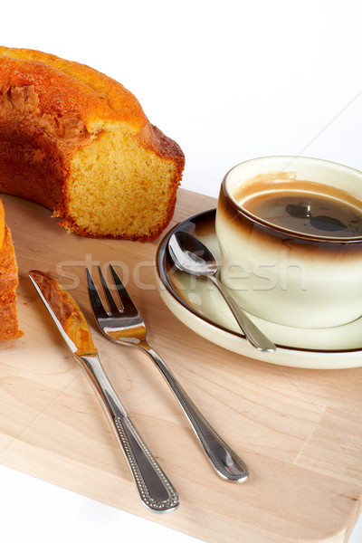 Sponge cake with the cup of coffee, spoon, knife and fork on wood plate Stock photo © broker