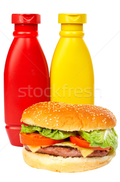 Burger with mustard and ketchup bottles Stock photo © broker