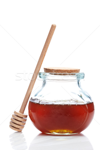 Honey jar and wooden drizzler Stock photo © broker