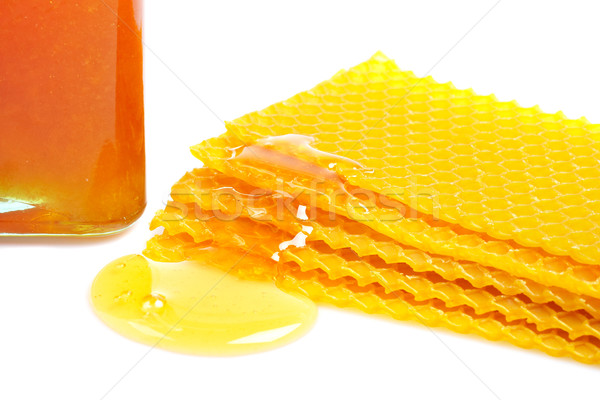 Honeycomb with honey and jar Stock photo © broker