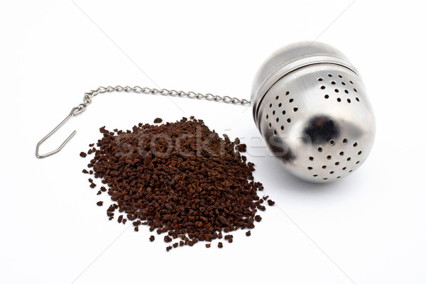 Tea and stainless steel tea ball on white background Stock photo © broker