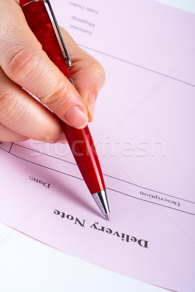 Writing blank delivery note with pen Stock photo © broker