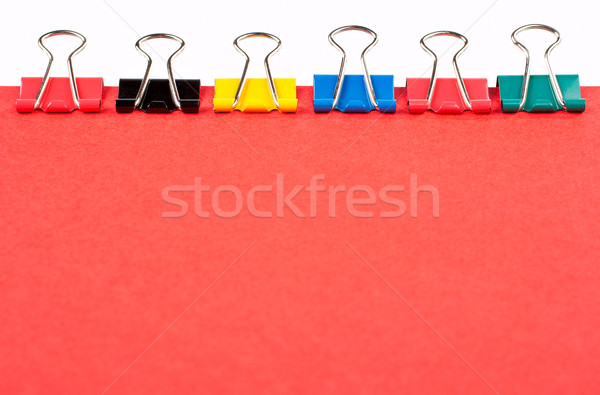 Colored paper clips lined up Stock photo © broker