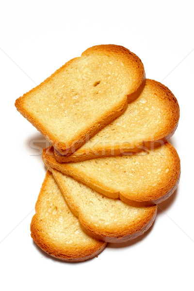 Some Slices of toasted bread isolated on white background Stock photo © broker