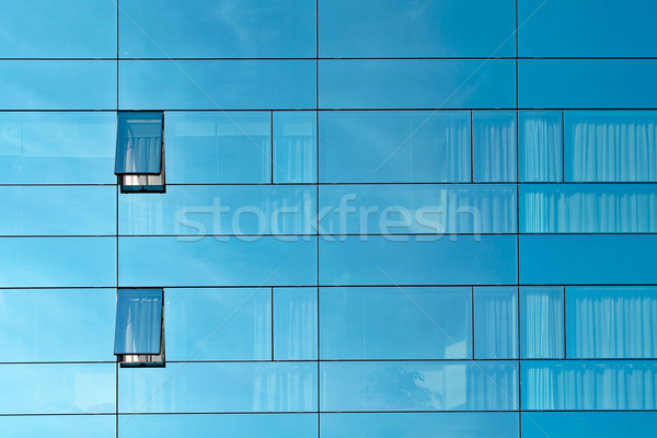 Reflection in an office building glass wall Stock photo © broker