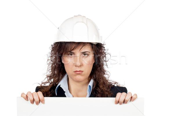 Woedend vrouwelijke architect achter witte kaart Stockfoto © broker