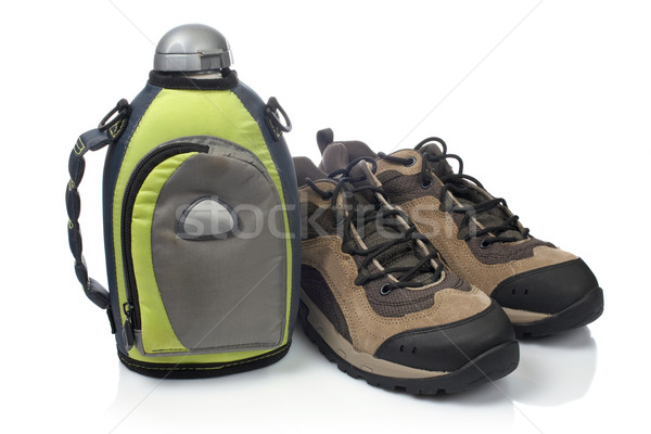 Hiking boots and canteen Stock photo © broker