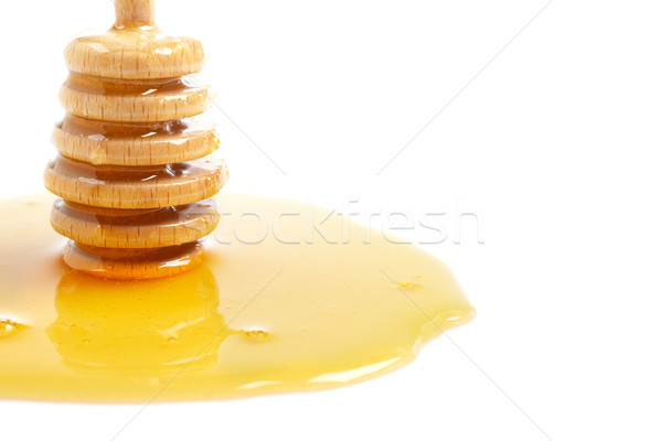 Honey and wooden drizzler Stock photo © broker