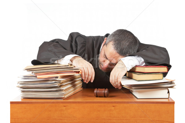 Male judge sleeping over the files Stock photo © broker