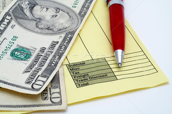 Blank invoice with pen and money (dollars) Stock photo © broker