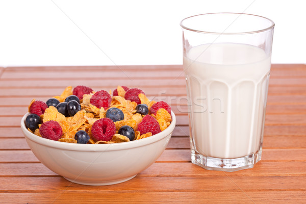 Cornflakes with fruits and milk tumbler Stock photo © broker