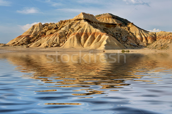 Hill reflected in the water Stock photo © broker
