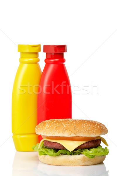 Cheeseburger senape ketchup bottiglie bianco poco profondo Foto d'archivio © broker