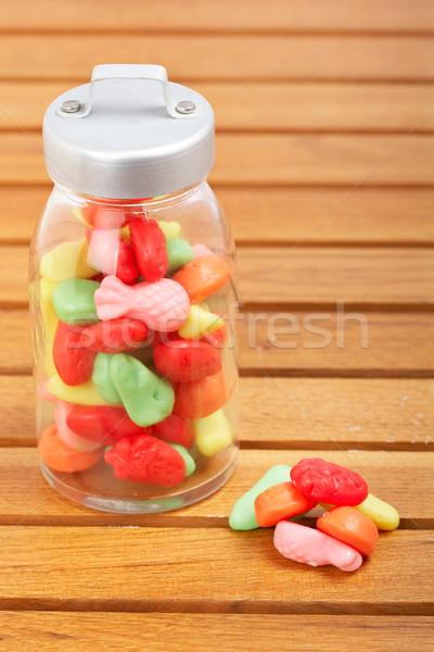 Cukorkák üveg bögre színes fából készült étel Stock fotó © broker