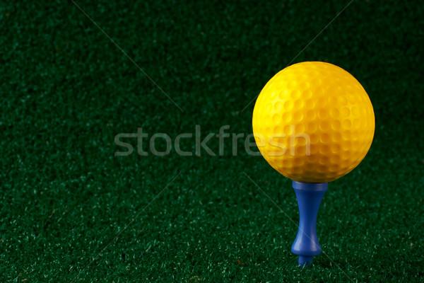 Yellow golfball and blue tee Stock photo © broker