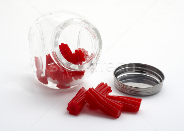 Pieces of red licorice on glass jar Stock photo © broker