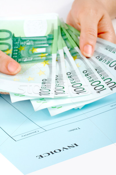 Holding money and invoice Stock photo © broker