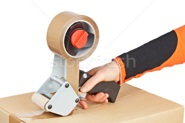 Packaging tape dispenser and shipping box Stock photo © broker