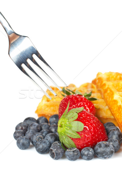 Waffles, blueberries and the fork pricking the strawberry Stock photo © broker