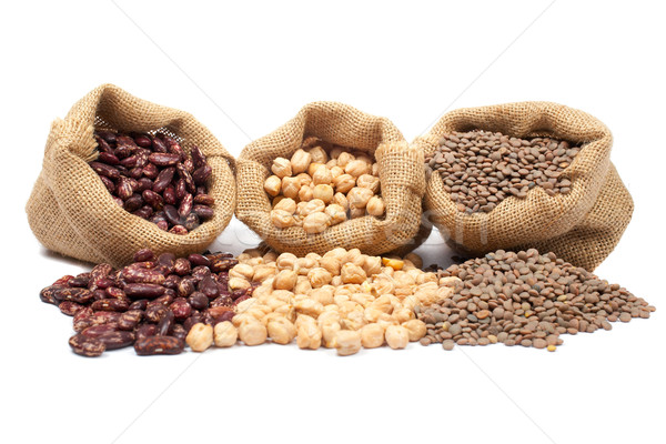 Lentils, chickpeas and red beans spilling out Stock photo © broker