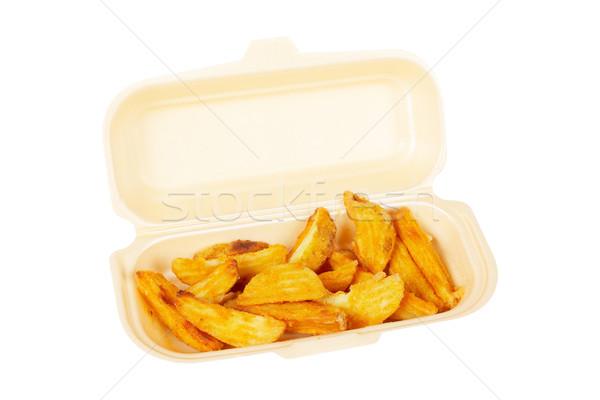 Potatoes on styrofoam container Stock photo © broker