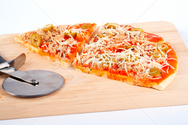 Detail of slices Italian pizza and cutter Stock photo © broker