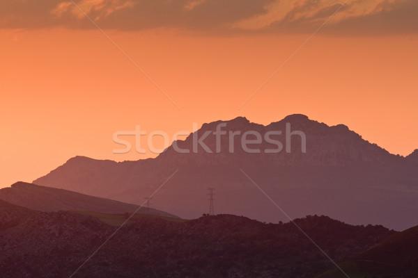 Alta tensione torri tramonto montagna natura luce Foto d'archivio © broker