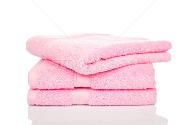 Rózsaszín törölközők egymásra pakolva pihen fürdőszoba szín Stock fotó © broker