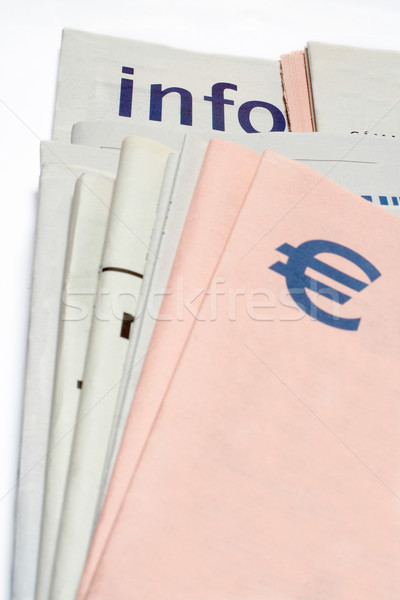 euro symbol on Stacked newspapers Stock photo © broker