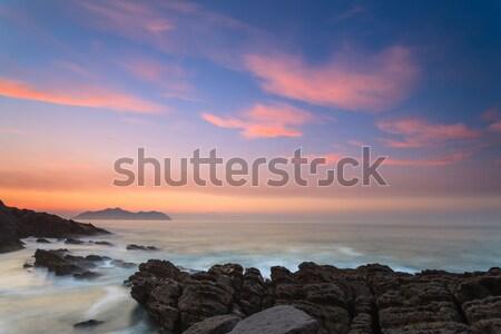 Verbazingwekkend zeegezicht zonsondergang hemel oceaan rock Stockfoto © broker