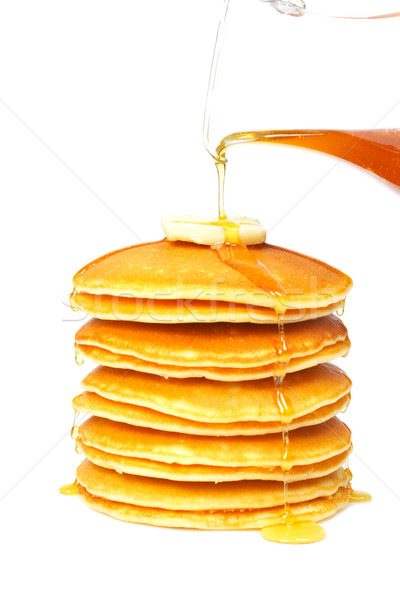 Pouring syrup on the pancakes Stock photo © broker
