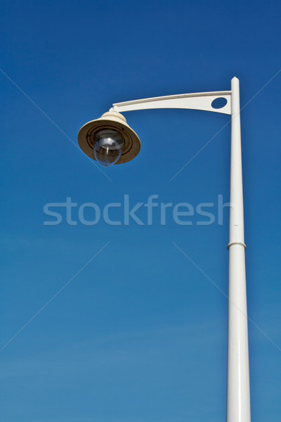 Lamppost over the blue sky Stock photo © broker