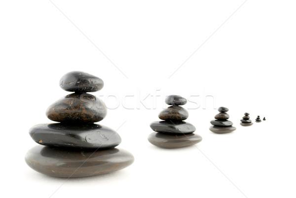 Kiegyensúlyozott kövek árnyék fehér masszázs ázsiai Stock fotó © broker