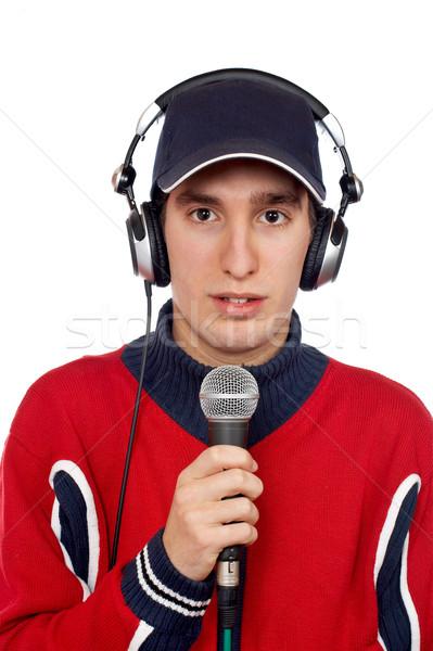 Discotecário fones de ouvido microfone branco mão homem Foto stock © broker