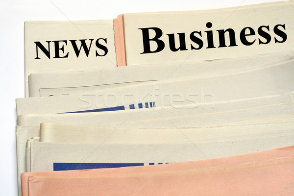 Stacked business newspapers Stock photo © broker