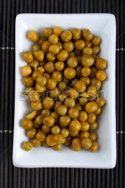 Peas on bamboo mat Stock photo © broker