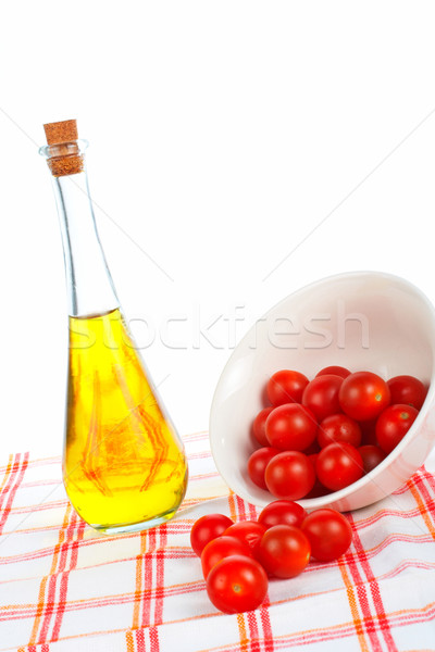 Olive oil bottle and tomatos cherry Stock photo © broker