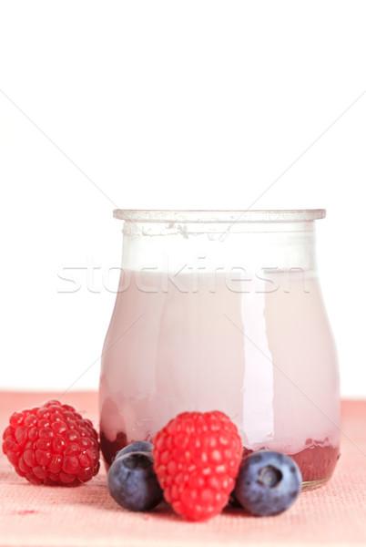 Yogurt and fresh raspberries and blueberries Stock photo © broker