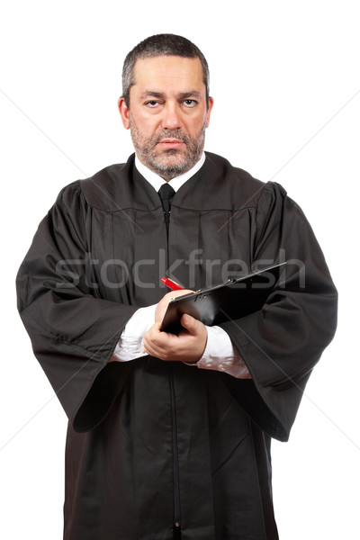 Serious male judge writing Stock photo © broker